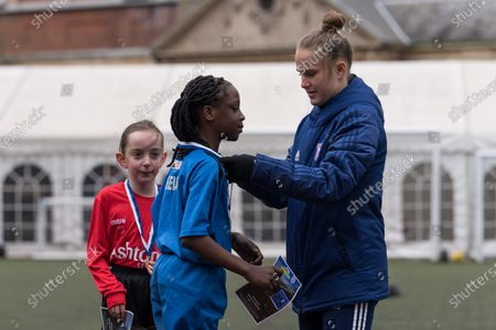 Stock Picture of Ipswich Town Women's Eva Hubbard works with local school children during the EFL Day of Action / Girls Football Festival at Portman Road.