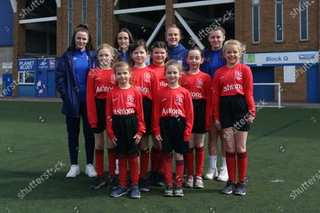 Local schools take part in the EFL Day of Action at Portman Road. Ipswich Town Women's players (L-R) Maria Boswell, Sophie Peskett, Eva Hubbard, and Maddie Biggs pose with children taking part in the activity