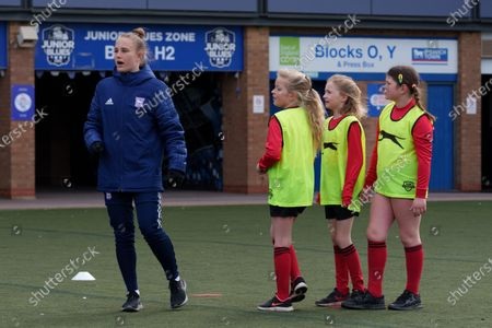 Stock Photo of Ipswich Town Women's Eva Hubbard works with local school children during the EFL Day of Action / Girls Football Festival at Portman Road.