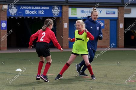 Ipswich Town Women's Eva Hubbard works with local school children during the EFL Day of Action at Portman Road