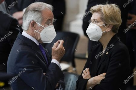 "Rep. Richard Neal, D-Mass., talks with Sen. Elizabeth Warren, D-Mass., as they wait for slain U.S. Capitol Police officer William ""Billy"" Evans to lie in honor at the Capitol in Washington DC"