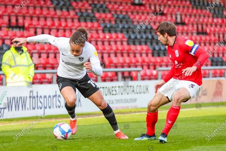 Portsmouth midfielder Marcus Harness (19)  takes on Crewe Alexandra defender Harry Pickering (3) during the EFL Sky Bet League 1 match between Crewe Alexandra and Portsmouth at Alexandra Stadium, Crewe