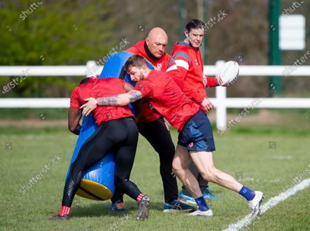 Stock Photo of Paul Anderson holds the tackle bag for Jermaine McGillvary & Daryl Clark.