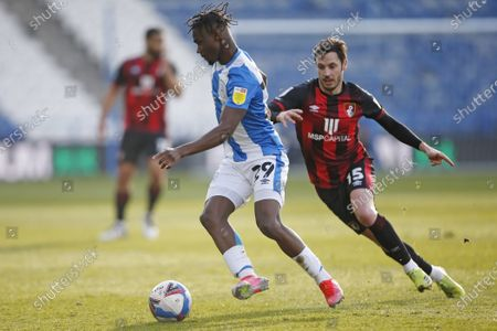 Stock Picture of Huddersfield Town's Aaron Rowe shields the ball from Adam Smith of Bournemouth  during the EFL Sky Bet Championship match between Huddersfield Town and Bournemouth at the John Smiths Stadium, Huddersfield