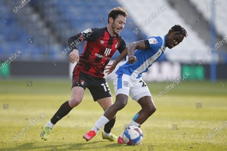 Stock Photo of Huddersfield Town's Aaron Rowe shields the ball from Adam Smith of Bournemouth  during the EFL Sky Bet Championship match between Huddersfield Town and Bournemouth at the John Smiths Stadium, Huddersfield