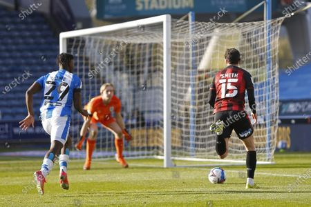 Adam Smith of Bournemouth goes past Huddersfield Town's Aaron Rowe during the EFL Sky Bet Championship match between Huddersfield Town and Bournemouth at the John Smiths Stadium, Huddersfield