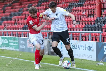 Stock Image of Portsmouth defender Charlie Daniels (21)  on the ball with Crewe Alexandra defender Harry Pickering (3) during the EFL Sky Bet League 1 match between Crewe Alexandra and Portsmouth at Alexandra Stadium, Crewe