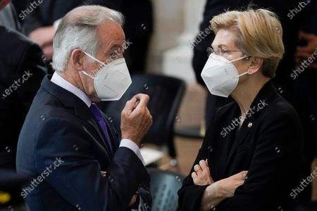 "Rep. Richard Neal, D-Mass., talks with Sen. Elizabeth Warren, D-Mass., as they wait for slain U.S. Capitol Police officer William ""Billy"" Evans to lie in honor at the Capitol in Washington,."