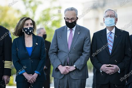 """From left, House Speaker Nancy Pelosi of Calif., Senate Majority Leader Chuck Schumer of N.Y., and Senate Minority Leader Mitch McConnell of Ky., wait for the flag-draped casket of U.S. Capitol Police officer William """"Billy"""" Evans, to be carried from the Capitol by a joint services honor guard Washington"""