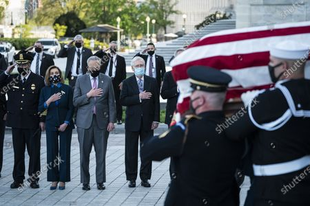 """From left, House Speaker Nancy Pelosi of Calif., Senate Majority Leader Chuck Schumer of N.Y., and Senate Minority Leader Mitch McConnell of Ky., watch as the flag-draped casket of U.S. Capitol Police officer William """"Billy"""" Evans, is carried from the Capitol by a joint services honor guard Washington"""