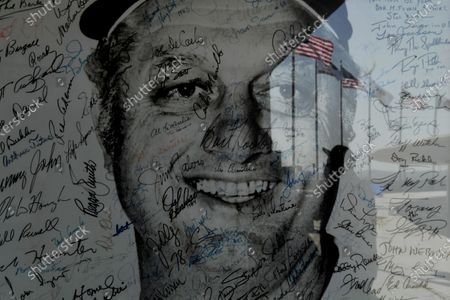 LOS ANGEL;ES, CALIFORNIA APRIL 8, 2021-An autograped photo of Dodgers legend Tommy Lasorda hangs at the top of the stadium at Dodger Stadium Thursday. (Wally Skalij/Los Angeles Times)