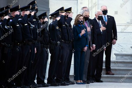 """Capitol Police officers and House Speaker Nancy Pelosi, Senate Majority Leader Chuck Schumer, Rep. Steny Hoyer, D-Md., and Rep. Steve Scalise, R-La., watch as the casket of slain U.S. Capitol Police officer William """"Billy"""" Evans is carried from the Capitol by a joint services honor guard Washington"""