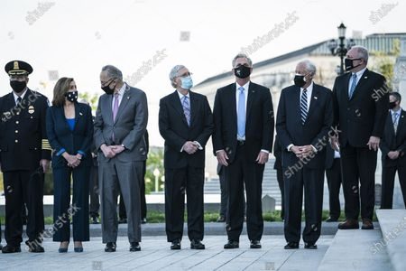 """From left, House Speaker Nancy Pelosi of Calif., Senate Majority Leader Chuck Schumer of N.Y., Senate Minority Leader Mitch McConnell of Ky., House Minority Leader Kevin McCarthy of Calif., House Majority Leader Steny Hoyer, D-Md., and Rep. Steve Scalise, R-La. wait for the flag-draped casket of U.S. Capitol Police officer William """"Billy"""" Evans, to be carried from the Capitol by a joint services honor guard Washington"""