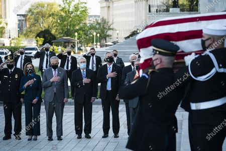"""From left, House Speaker Nancy Pelosi of Calif., Senate Majority Leader Chuck Schumer of N.Y., Senate Minority Leader Mitch McConnell of Ky., and House Minority Leader Kevin McCarthy of Calif., watch as the flag-draped casket of U.S. Capitol Police officer William """"Billy"""" Evans, is carried from the Capitol by a joint services honor guard Washington"""