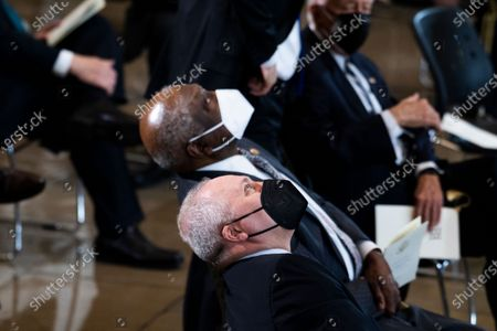 House Minority Whip Steve Scalise, R-La., and House Majority Whip Jim Clyburn, D-S.C., center, attend the service for U.S. Capitol Officer William ÒBillyÓ Evans, as his remains lie in honor in the Capitol Rotunda in Washington, DC, USA, on 13 April 2021. Officer Evans was killed in the line of duty 02 April when a driver rammed his vehicle into Evans and another officer before crashing into a security barrier at the North entrance to the Capitol.