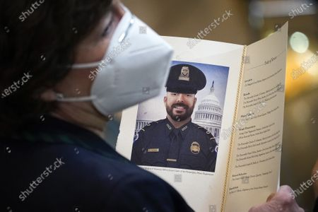 """Stock Photo of WASHINGTON, DC - APRIL 13: Sen. Susan Collins (R-ME) holds a program during a memorial service for the late U.S. Capitol Police officer William """"Billy"""" Evans as he lies in honor in the Rotunda at the U.S. Capitol in Washington, DC. Officer Evans was killed in the line of duty during the attack outside the U.S. Capitol on April 2. He is the sixth Capitol Police officer to die in the line of duty in the nearly 200 years since the force was created."""