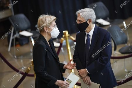 "WASHINGTON, DC - APRIL 13: Sen. Elizabeth Warren (D-MA) speaks with Attorney General Merrick Garland as they arrive at a memorial service for the late U.S. Capitol Police officer William ""Billy"" Evans as he lies in honor in the Rotunda at the U.S. Capitol in Washington, DC. Officer Evans was killed in the line of duty during the attack outside the U.S. Capitol on April 2. He is the sixth Capitol Police officer to die in the line of duty in the nearly 200 years since the force was created."