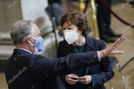 """WASHINGTON, DC - APRIL 13: Sen. Tim Kaine (D-VA) speaks with Sen. Susan Collins (R-ME) as they arrive at a memorial service for the late U.S. Capitol Police officer William """"Billy"""" Evans as he lies in honor in the Rotunda at the U.S. Capitol in Washington, DC. Officer Evans was killed in the line of duty during the attack outside the U.S. Capitol on April 2. He is the sixth Capitol Police officer to die in the line of duty in the nearly 200 years since the force was created."""