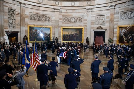 """Stock Image of UNITED STATES - APRIL 13: An honor guard places the remains of U.S. Capitol Police Officer William """"Billy"""" Evans on the Lincoln catafalque to lie in honor in the Capitol Rotunda in Washington, D.C.,. Evans was killed when a driver rammed the north barricade of the Capitol."""