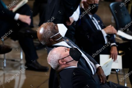 """UNITED STATES - APRIL 13: United States House Minority Whip Steve Scalise (Republican of Louisiana), and US House Majority Whip James Clyburn (Democrat of South Carolina), center, attend the service for U.S. Capitol Officer William """"Billy"""" Evans, as his remains lie in honor in the Capitol Rotunda in Washington, D.C.,. Evans was killed when a driver rammed the north barricade of the Capitol."""