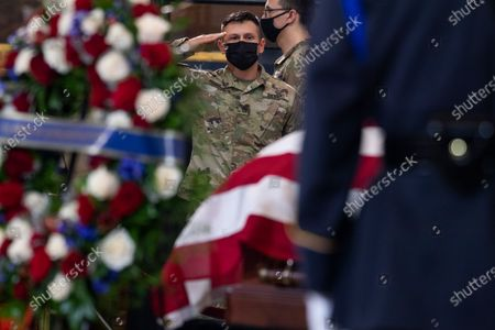 """UNITED STATES - APRIL 13: A member of the National Guard pays respects to U.S. Capitol Police Officer William """"Billy"""" Evans, as his remains lie in honor in the Capitol Rotunda in Washington, D.C.,. Evans was killed when a driver rammed the north barricade of the Capitol."""