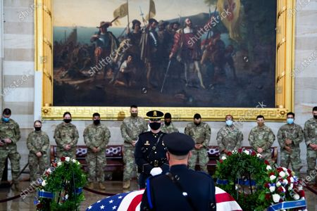 """UNITED STATES - APRIL 13: National Guardsmen pay respects to Capitol Officer William """"Billy"""" Evans, as his remains lie in honor in the Capitol Rotunda in Washington, D.C.,. Evans was killed when a driver rammed the north barricade of the Capitol."""