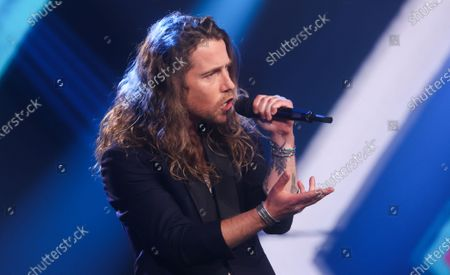 Stock Picture of Singer Julien Dore performs during the final of television show 'The Voice Belgique', by Belgian French-speaking television station RTBF, Tuesday 13 April 2021 in Liege Mediacite.