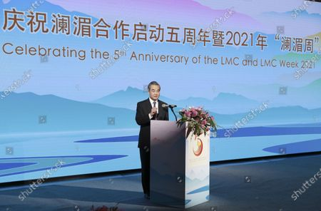 (210413) - BEIJING, April 13, 2021 (Xinhua) - Chinese State Councilor and Foreign Minister Wang Yi addresses a reception celebrating the 5th anniversary of the Lancang-Mekong Cooperation (LMC) in Beijing, capital of China, April 13, 2021.