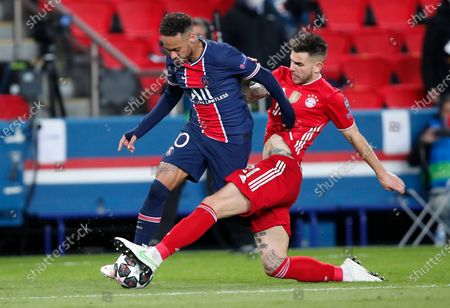 PSG's Neymar, left, and Bayern's Lucas Hernandez challenge for the ball during the Champions League, second leg, quarterfinal soccer match between Paris Saint Germain and Bayern Munich at the Parc des Princes stadium, in Paris, France
