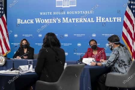 Vice President Kamala Harris and White House Domestic Policy Advisor Susan Rice listen during a roundtable discussion on Black maternal health in the South Court Auditorium
