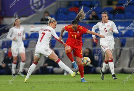 Natasha Harding of Wales is challenged by Sanne Troelsgaard of Denmark