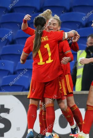 Jess Fishlock of Wales is congratulated by Natasha Harding of Wales after scoring goal