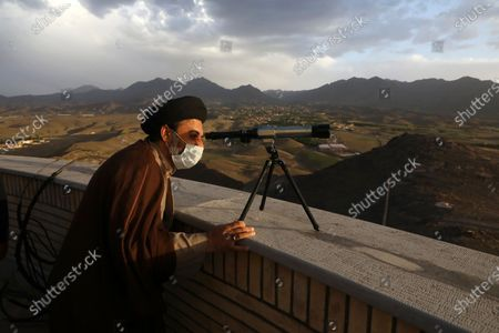 Clergyman searches the sky with a telescope for the new moon that signals the start of the Islamic holy fasting month of Ramadan, at the Imam Ali observatory about 28 miles (45 kilometers) outside the holy city of Qom, south of the capital Tehran, Iran, . Muslims around the world are observing Ramadan, the holiest month in Islamic calendar, where they refrain from eating, drinking, smoking, and sex from dawn to dusk