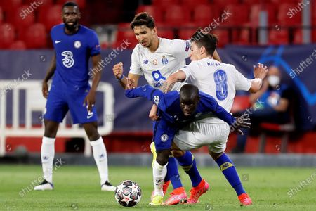 Chelsea's midfielder N'Golo Kante (C) vies for the ball against Porto's Marko Grujic (2-L) and Matheus Uribe (R) during the UEFA Champions League quarterfinal, second leg soccer match between Chelsea FC and Porto FC at Ramon Sanchez Pizjuan stadium in Seville, Andalusia, Spain, 13 April 2021.