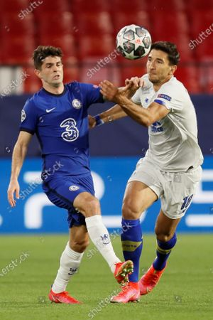 Chelsea's winger Christian Pulisic (L) duels for the ball against Porto's midfielder Marko Grujic (R) during the UEFA Champions League quarterfinal, second leg soccer match between Chelsea FC and Porto FC at Ramon Sanchez Pizjuan stadium in Seville, Andalusia, Spain, 13 April 2021.