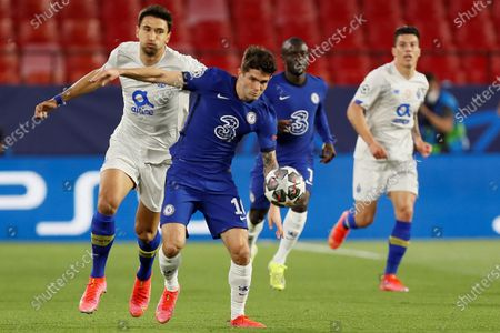 Chelsea's winger Christian Pulisic (2-L) duels for the ball against Porto's midfielder Marko Grujic (L) during the UEFA Champions League quarterfinal, second leg soccer match between Chelsea FC and Porto FC at Ramon Sanchez Pizjuan stadium in Seville, Andalusia, Spain, 13 April 2021.