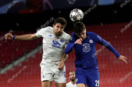 Chelsea's midfielder Kai Havertz (R) duels for the ball against Porto's midfielder Marko Grujic (L) during the UEFA Champions League quarterfinal, second leg soccer match between Chelsea FC and Porto FC at Ramon Sanchez Pizjuan stadium in Seville, Andalusia, Spain, 13 April 2021.