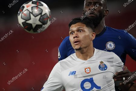 Stock Picture of Evanilson of Porto and Antonio Rudiger of Chelsea  compete for the ball during the UEFA Champions League Quarter Final Second Leg match between Chelsea FC and FC Porto at Estadio Ramon Sanchez Pizjuan on April 13, 2021 in Seville, Spain. Sporting stadiums around Spain remain under strict restrictions due to the Coronavirus Pandemic as Government social distancing laws prohibit fans inside venues resulting in games being played behind closed doors.