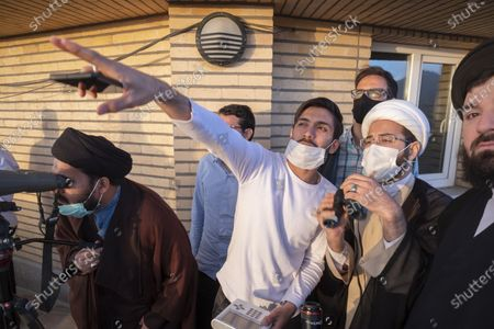 Clerics and an astronomer during a ceremony for observation of the new moon of Muslim's holy month of Ramadan in the Imam Ali observatory in Kahak area near the holy city of Qom 145Km (90 miles) south of Tehran at sunset, amid the COVID-19 outbreak in Iran, April 13, 2021.