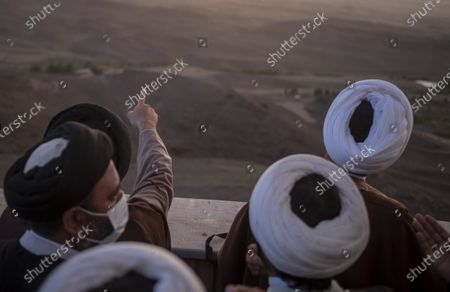 Clerics attend a ceremony for observation of the new moon of Muslim's holy month of Ramadan in the Imam Ali observatory in Kahak area near the holy city of Qom 145Km (90 miles) south of Tehran at sunset, amid the COVID-19 outbreak in Iran, April 13, 2021.