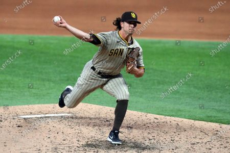 Stock Image of San Diego Padres relief pitcher Taylor Williams (45) delivers a pitch against the Texas Rangers during a baseball game, in Arlington, Texas