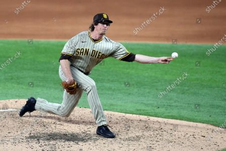 San Diego Padres pitcher Tim Hill (25) delivers a pitch against the Texas Rangers in the sixth inning during a baseball game, in Arlington, Texas