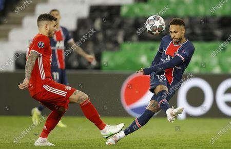 Bayern's Lucas Hernandez (L) and Paris Saint Germain's Neymar Jr (R) in action during the UEFA Champions League quarterfinal second leg soccer match between  Paris Saint-Germain and FC Bayern Munich, in Paris, France, 13 April 2021.