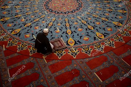 A worshipper prays as he marks the beginning of Ramadan at the Nizamiye Mosque in Johannesburg, South Africa, 13 April 2021. Muslims around the world celebrate the holy month of Ramadan by praying during the night time and abstaining from eating, drinking, and sexual acts during the period between sunrise and sunset. Ramadan is the ninth month in the Islamic calendar and it is believed that the revelation of the first verse in Koran was during its last 10 nights. The mosque is a copy of the 'Blue Mosque' in Istanbul and was build by a Turkish businessman Ali Katircioglu. The mosque claims to be the biggest in the southern hemisphere.