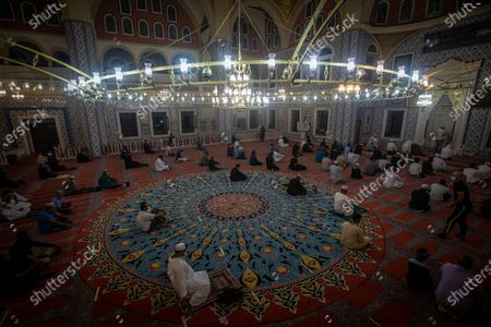 Worshipers pray as they mark the beginning of Ramadan at the Nizamiye Mosque in Johannesburg, South Africa, 13 April 2021. Muslims around the world celebrate the holy month of Ramadan by praying during the night time and abstaining from eating, drinking, and sexual acts during the period between sunrise and sunset. Ramadan is the ninth month in the Islamic calendar and it is believed that the revelation of the first verse in Koran was during its last 10 nights. The mosque is a copy of the 'Blue Mosque' in Istanbul and was build by a Turkish businessman Ali Katircioglu. The mosque claims to be the biggest in the southern hemisphere.