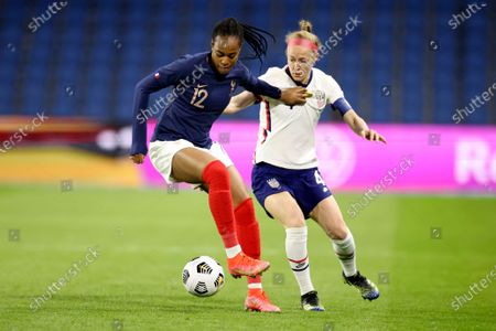 Stock Image of France's Marie-Antoinette Katoto (12) shields the ball from United States' Becky Sauerbrunn during the first half of an international friendly women's soccer match between the United States and France in Le Havre, France