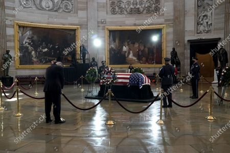 Rep. Dan Kildee (D-Mich.) pays his respects to US Capitol Police officer William Evans as he lies in honor at the U.S. Capitol in Washington, DC, USA, on 13 April 2021.