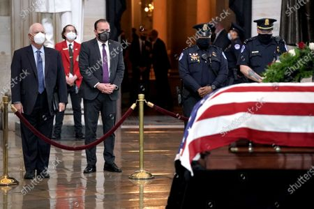 Stock Picture of Sens. Ben Cardin (D-Md.) (L) and Mike Lee (R-Utah) pay their respects to US Capitol Police officer William Evans as he lies in honor at the U.S. Capitol in Washington, DC, USA, on 13 April 2021.