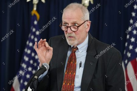 Stock Image of John Douglas, executive director of Tri-County Health Department, makes a point about efforts to curb the spread of the coronavirus in the state during a news conference, at the Governor's Mansion in Denver