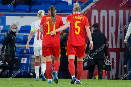 Natasha Harding (11 Wales) and Rhiannon Roberts (5 Wales) walks off the pitch together at half time  during the International Friendly game between Wales and Denmark at Cardiff City Stadium in Cardiff, Wales.